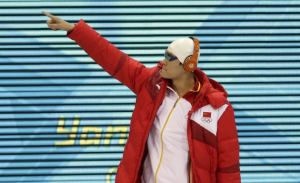 Sun Yang wearing customized Beats by Dr. Dre head phones